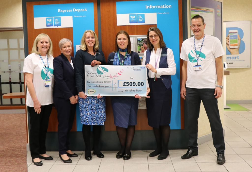 Lindsey Richards of the hospice appeal is pictured (far left), with Chris Smith of the hospice appeal (far right), together with staff from the Doncaster branch of Yorkshire Bank.