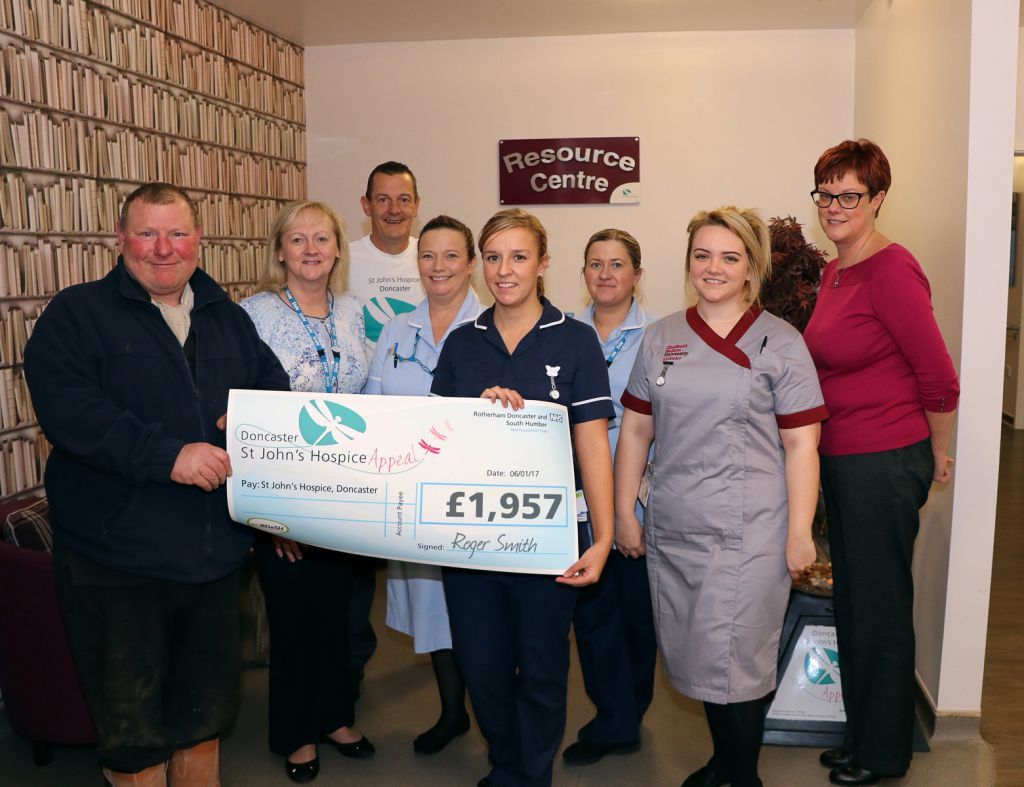 Roger Smith is pictured far left together with staff from St John's Hospice and from the hospice appeal.
