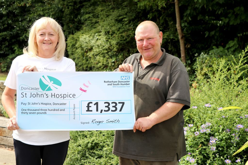 Roger is pictured (right) handing over £1,337 to Lindsey Richards of St John's Hospice.
