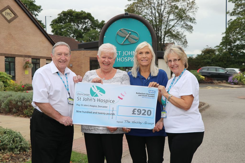 Deborah Lanceley and Jayne Gill (second and third from left) are pictured handing over the cheque with hospice staff.