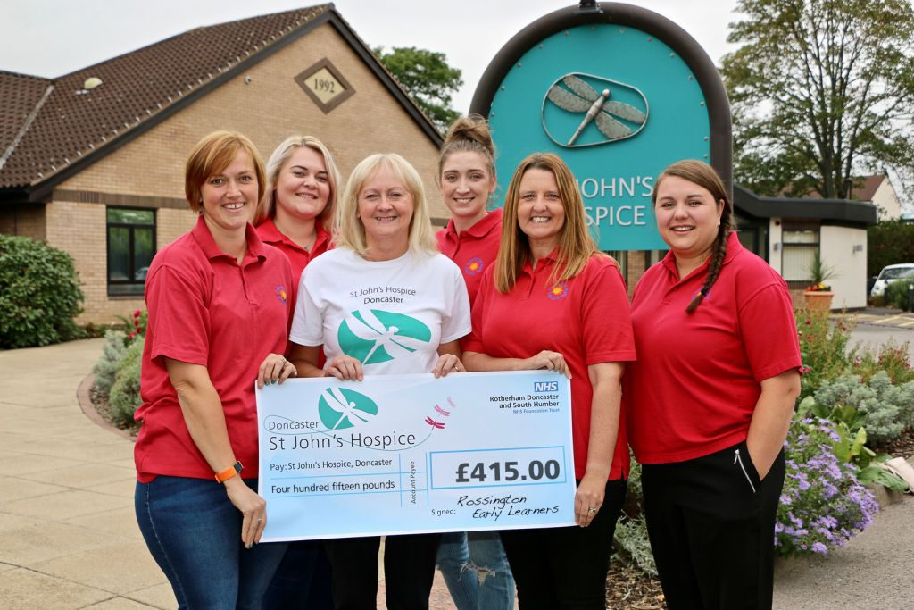 Staff from the Rossington Early Learners are pictured handing over their cheque to Lindsey Richards (centre) of St John's Hospice.