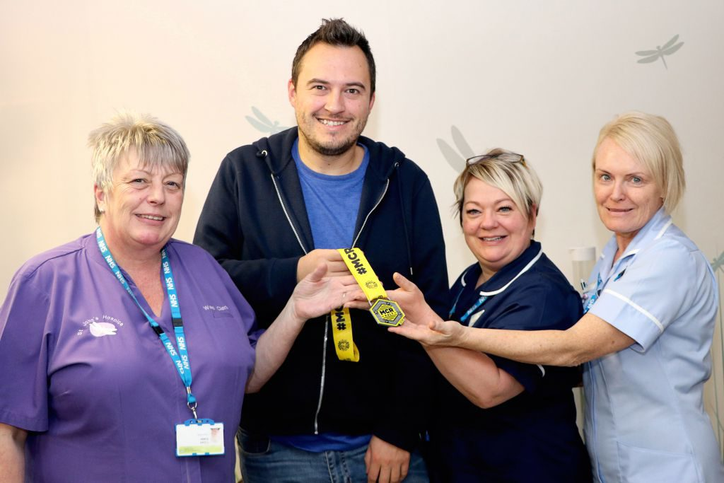 Matt is pictured with hospice staff