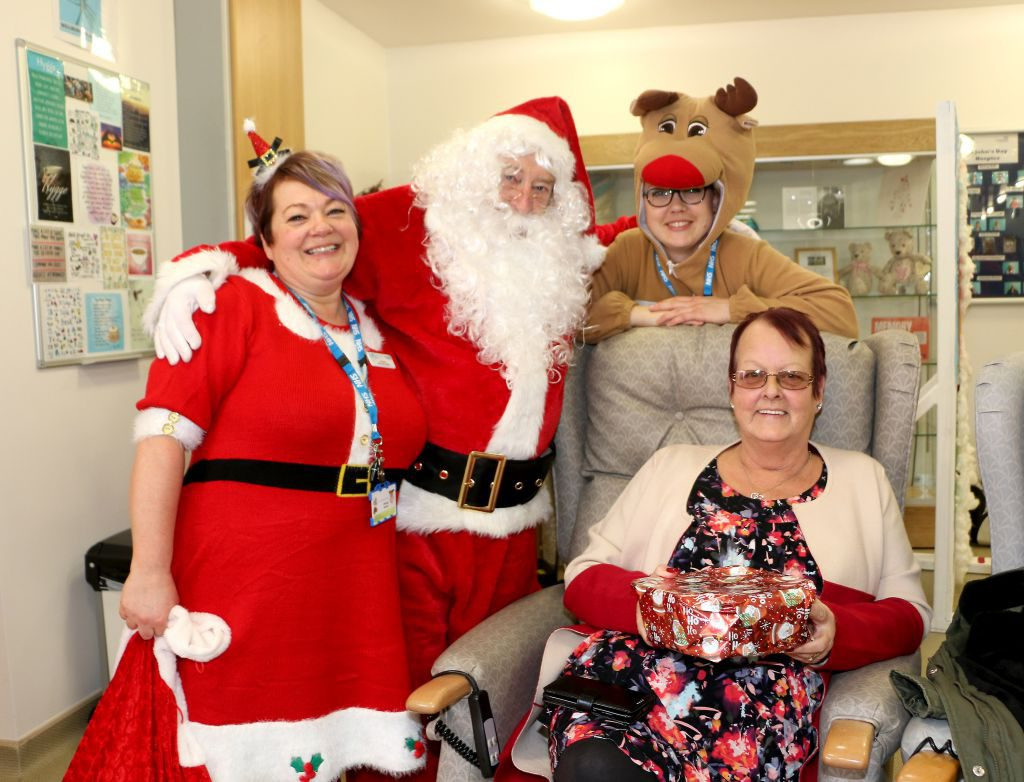 Hospice Sister Joanne Brooks is pictured with Father Christmas, Rudolf and hospice visitor Jane Birchall, who attended the event with her sister Ann.
