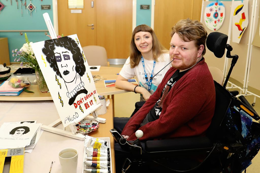 Philip Hood is pictured with his painting and Hospice Art Therapist Rachel Horne.