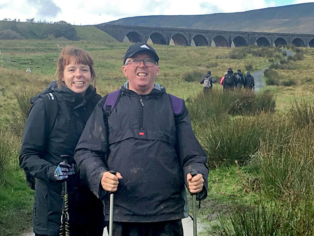 Dave and Jenny are pictured at Ribblehead Viaduct training for their climb