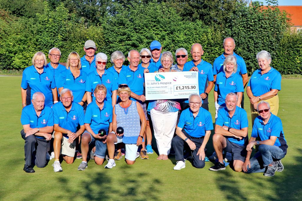 Maureen Harwood, of St John's Hospice, is pictured (middle row, 5th from the left), with Les Crownshaw (middle row, 6th from left) surrounded by members of Tickhill Bowling Club.