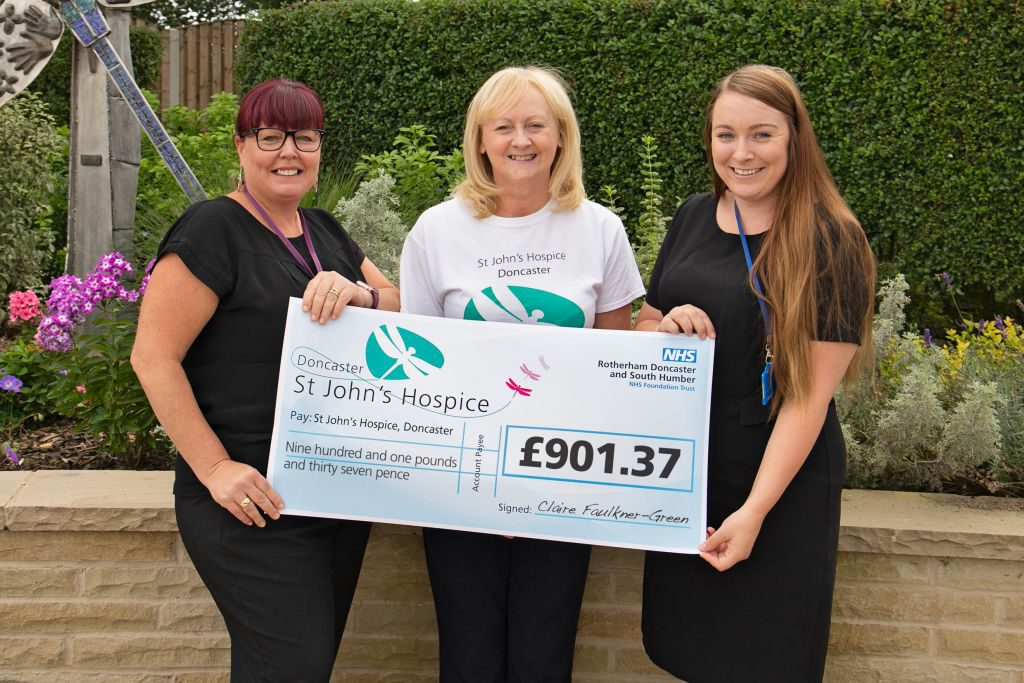 Left to right Claire is pictured with Lindsay Richards of the hospice and a colleague.)