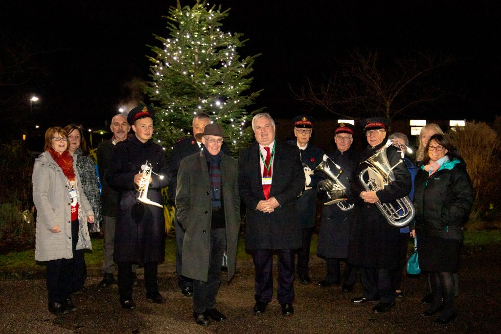 The Salvation Army's brass band is pictured with RDaSH staff.