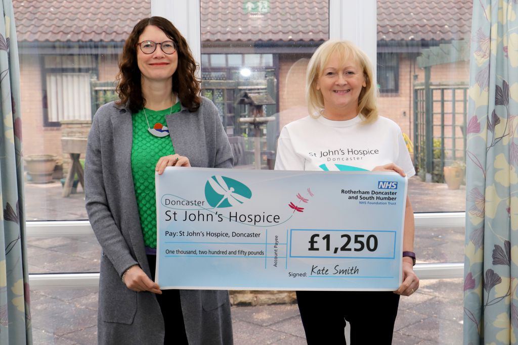 Kate (left) is pictured with Lindsey Richards of the hospice (right).