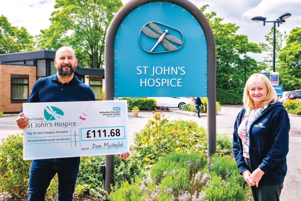 Dean presenting his cheque to Lindsey at the hospice